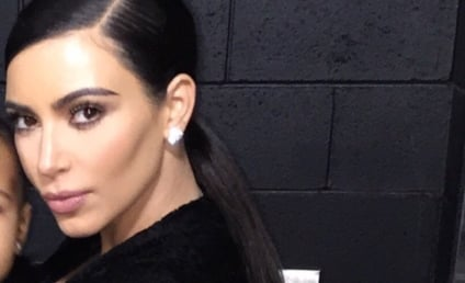 Kim Kardashian Krops Daughter Out of Selfie