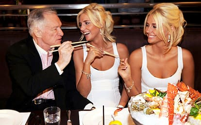 Hef and his Twins
