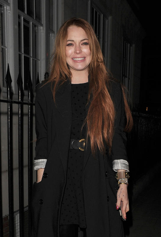 Lindsay Lohan Tries to Smile