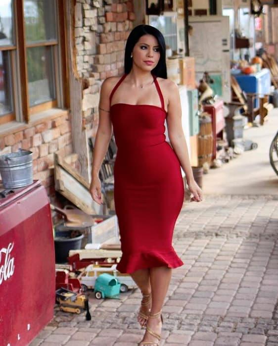 Larissa lima models a red dress