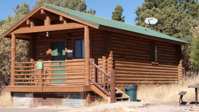 It's a literal cabin, like you'd see in a coloring book
