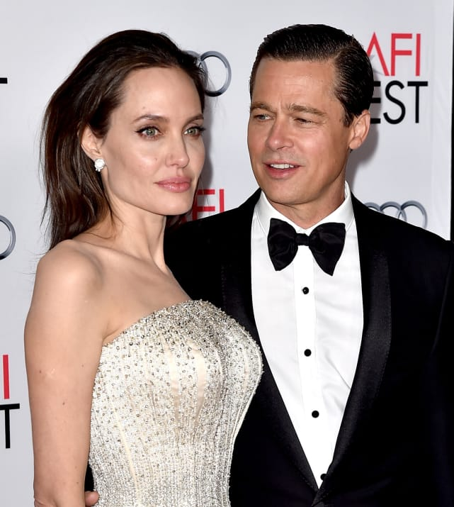 Brad pitt and angelina jolie pose