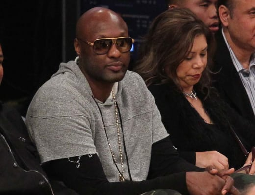 Lamar Odom Sits Courtside