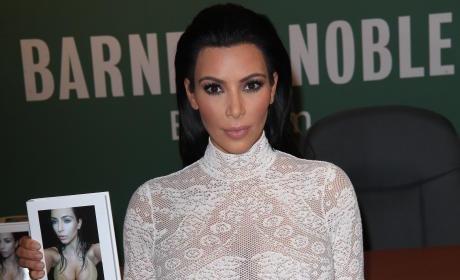 Kim Kardashian with Selfie Book