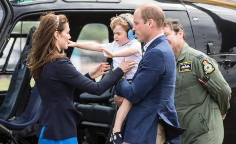 Prince George Reaches For Kate Middleton
