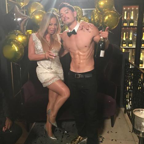 Bryan Tanaka and Mariah Carey