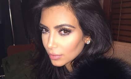 Kim Kardashian: Pregnancy Cleavage on Full Display in France!