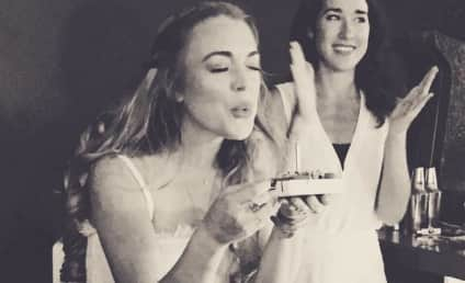 Lindsay Lohan Celebrates Birthday With Sister, Blow(ing Out Candles on Cake)