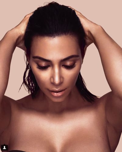 Kim Kardashian Looks at Herself