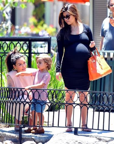 Pregnant Kourtney Kardashian and Mason