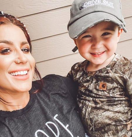 Chelsea Houska holds a Son