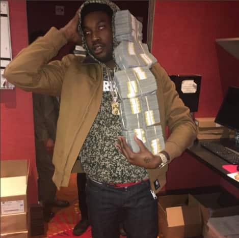Meek Mill carries piles of cash