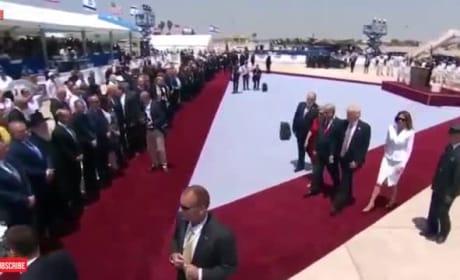 Melania Trump Swats Donald's Hand Away in Viral Video!