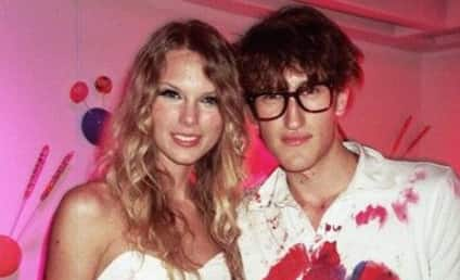 Taylor Swift Poses with Jew-Hating, Swastika Lover