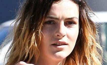 Lindsay Lohan Shoots Down Sister Boob Job Rumors