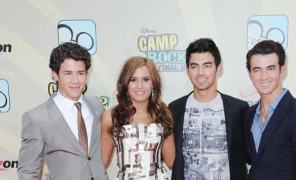Tournament of THG: Demi Lovato vs. Taylor Lautner!