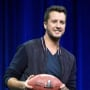 Luke Bryan with a Football
