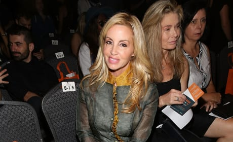 Camille Grammer with Legs Crossed
