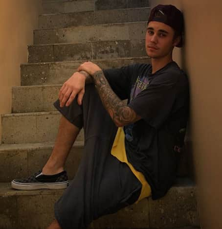 Justin Bieber Sits on Stairs
