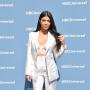 Kourtney Kardashian in a White Pantsuit Photo