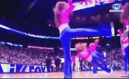 Cheerleader Cracks Head on Court, Taken Off on Stretcher