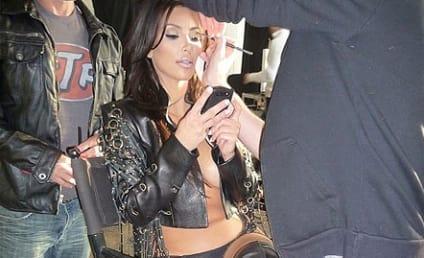"Kim Kardashian Goes ""Calendar Glam,"" Braless for Throwback Thursday"