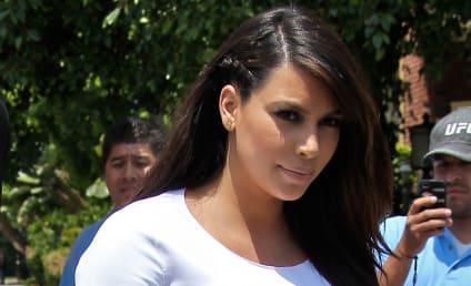 Kim Kardashian to Take Baby on Tour: Right or Wrong?
