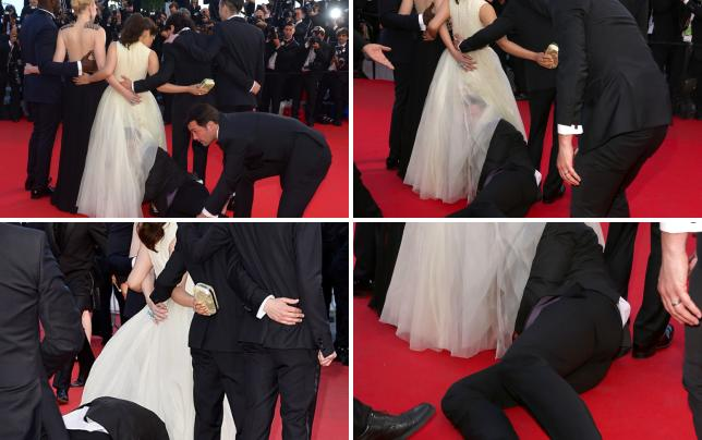 Guy crawls under america ferreras dress