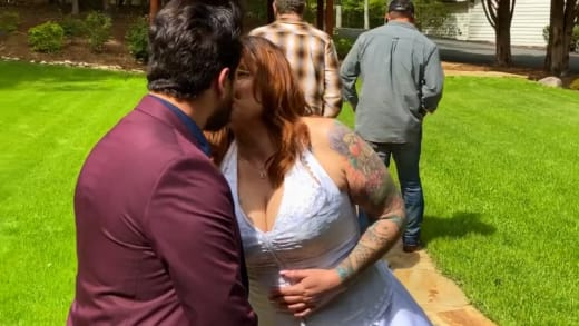 Rebecca Parrott kisses Zied Hakimi on their wedding day