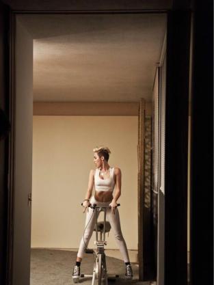 Miley Cyrus Straddles Bike