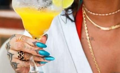 Rihanna Rocks Bikinis, Pounds Booze in Racy Vacation Pics