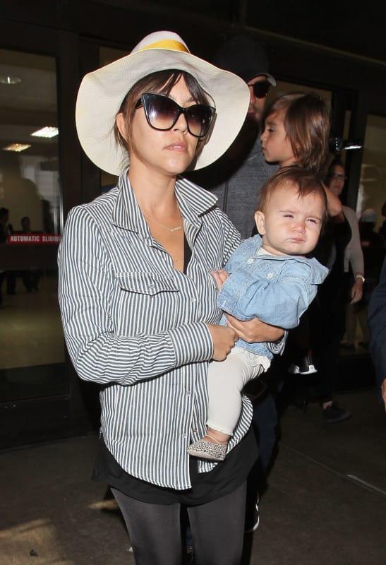 Kourtney Kardashian Holds Penelope