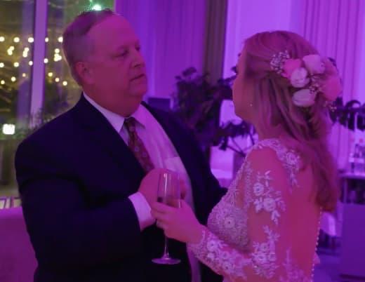 Elizabeth Potthast and Chuck Potthast at the reception, purple lights