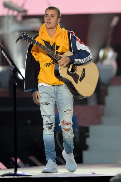 Justin Bieber Holds Guitar