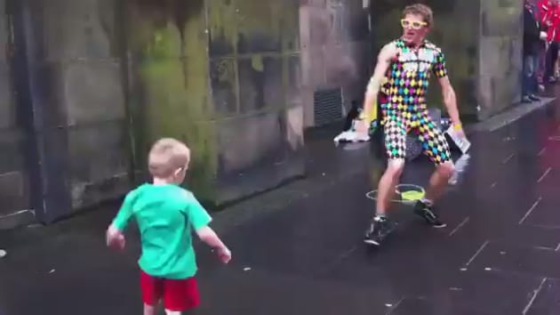 little kid dances with street performer puts on terrific