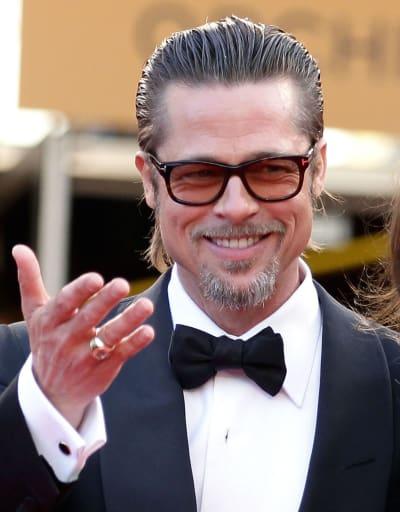Brad Pitt Wearing Glasses and Smiling