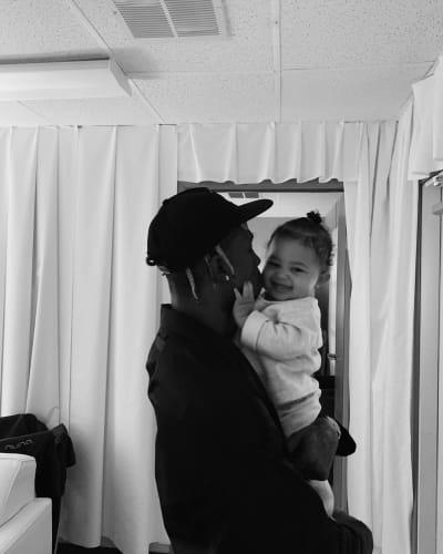 Travis Scott Holds Baby Stormi