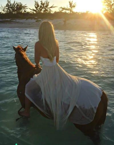 Kim Zolciak on a Horse