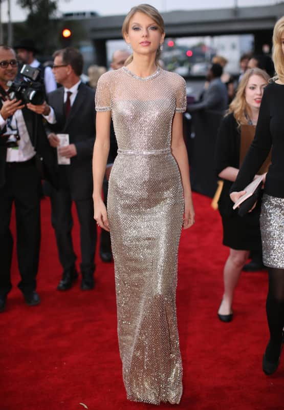 Taylor swift in a gold dress photo