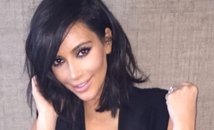 "Kim Kardashian Flaunts ""Today's Vibes,"" A LOT of Cleavage"