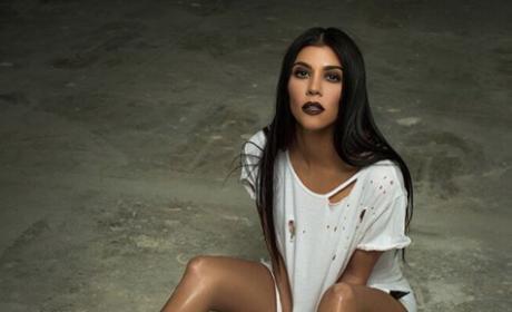 Kourtney Kardashian in ripped white tee