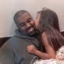 North West Kisses Kanye West