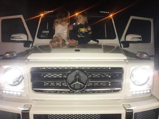 Kourtney Kardashian Kids on a Car