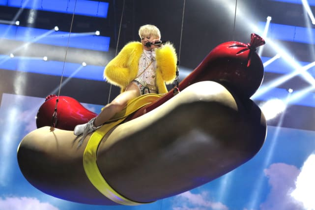 Miley Cyrus on a Hot Dog