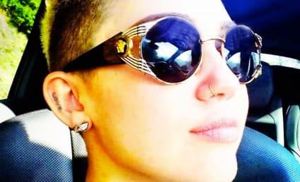 "Miley Cyrus Denies ""Tweet Heat"" with Taylor Swift"