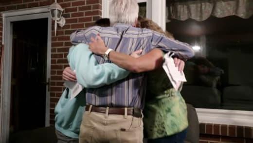 Gibbs family hugs Julia Trubkina