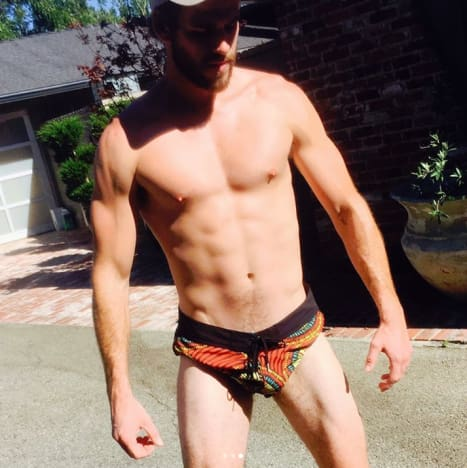 Liam Hemsworth Flexes in Tiny Shorts