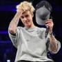 Justin Bieber Runs Hand Through Hair