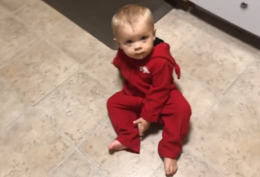 Samuel Dillard in a Onesie on the Floor