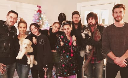 Liam Hemsworth & Miley Cyrus Pose For Hilariously Awkward Christmas Photo
